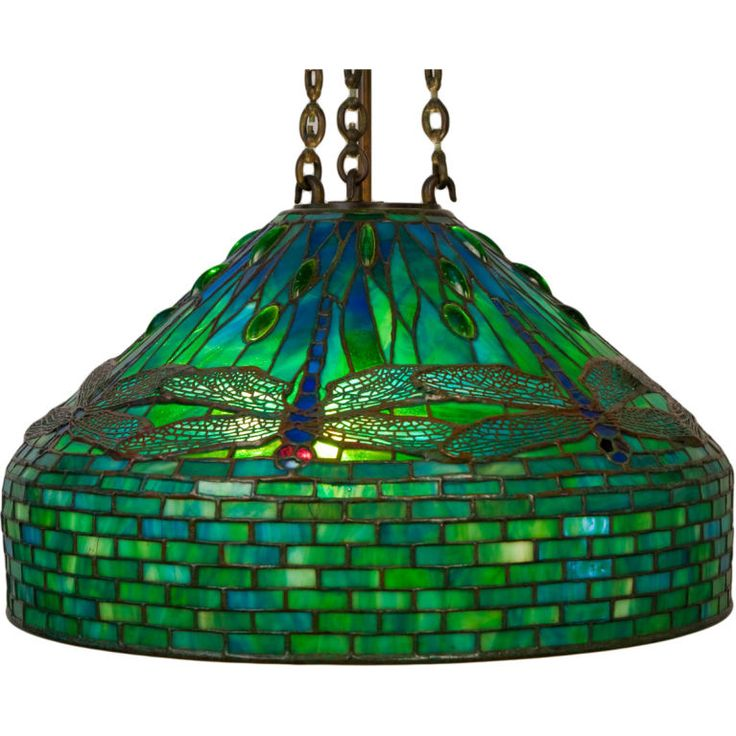 "circa 1910 - Art Nouveau  Tiffany Studios patinated bronze ""Dragonfly"" chandelier decorated with blue dragonfly bodies decorated with aqua - green wings further enhanced with red eyes and all over green cabachon jewels against a green - blue background with extended geometric brick skirt. The shade is impressed, ""Tiffany Studios New York"""