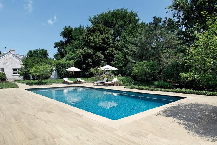 Beautiful poolside decking using timber-look porcelain tiles