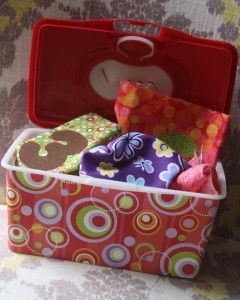 fabric scraps in a diaper wipe container for kiddos who like to