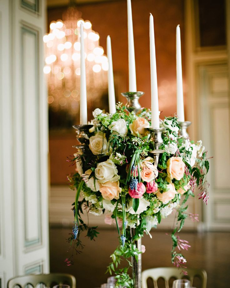 Roses and jasmine embellished large candelabras for this wedding in Vienna.