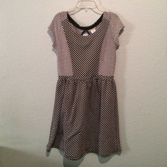 Black and Whit Polka Dot Dress Cute black and white polka dot dress with oval cut out in the back. Only worn twice! Perfect condition and no damage! A perfect winter dress!! Cooperative Dresses
