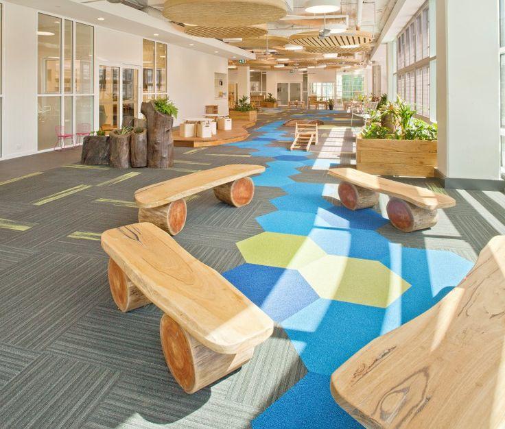 "Indoors - natural log ""Skateboard Seats"" and log planters"