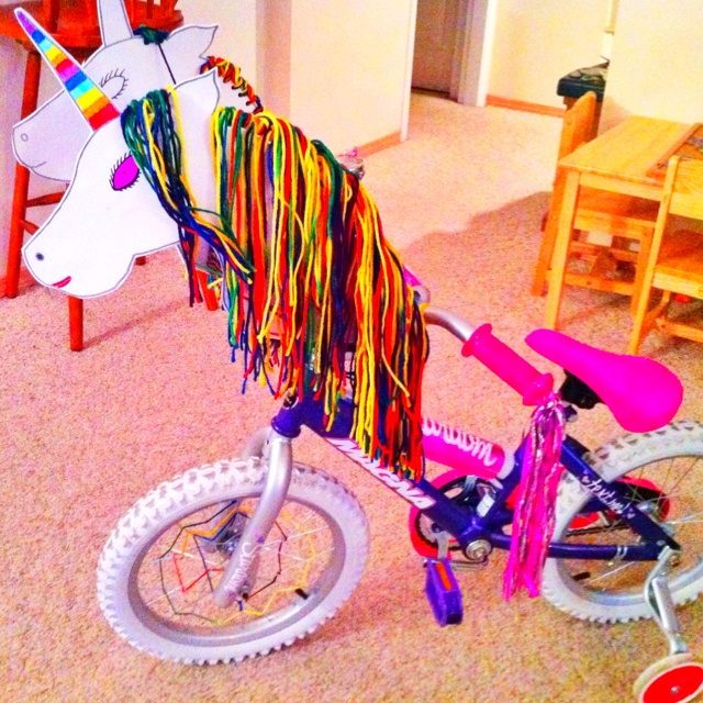 I made my daughter a unicorn bicycle for a parade. So easy. Foam pieces and rainbow yarn. Drew the unicorn, cut it out, hole punched holes on the mane and strung with 5 pieces of yarn in each. Everyone loved this in the parade.