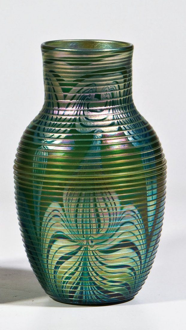 dating tiffany favrile glass An antique tiffany studios favrile glass vase the hand blown vase features an oblate form with a thin rim and an irregular green vine pattern to the blue iridescent glass body it is signed.