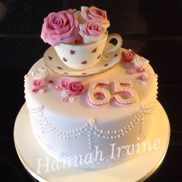 65th birthday cake with fondant tea cup and sugar roses