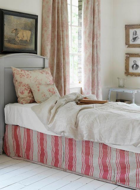 As a whole probably a bit grand for the average cottage bedroom but there is some great ideas to draw upon.  I love the colour scheme with accents of dove grey.  I also love the idea of selecting your own choice of fabric to create a boxed valance, it really adds something extra to the look.. Cabbages and Roses
