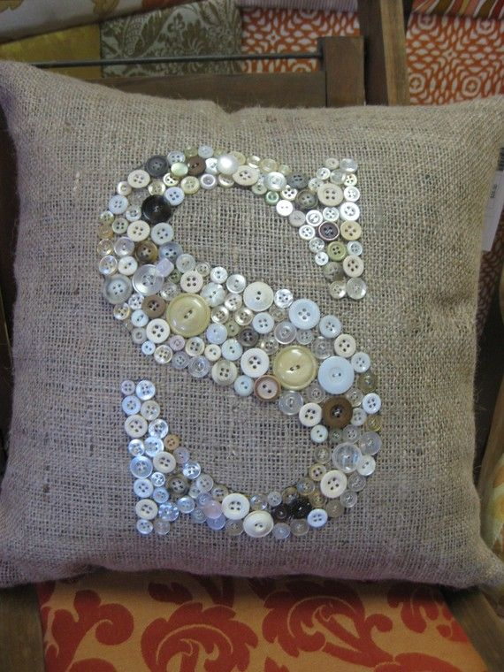 Thinking of using burlap and broken seas shells ++ framing it instead of making a pillow.