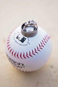 A classic wedding ring shot-the wedding and engagement rings on a baseball #Phillieswedding #baseballweddings #engagementshoot