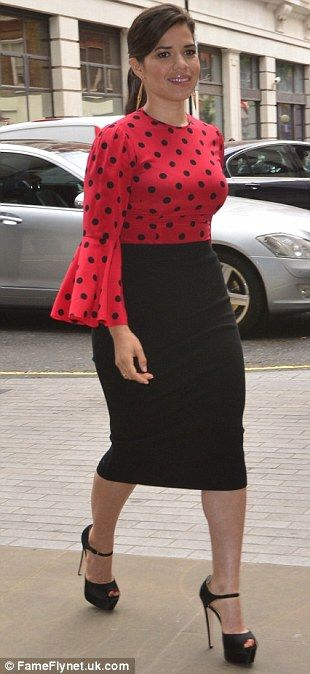 Sexy senorita! America Ferrera steps out in scarlet polka dot flamenco style top and pencil skirt for radio interview in London