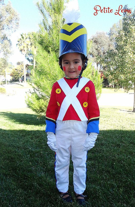 Christmas Toy Soldier Costume nutcracker vinyl hat feather plume yellow toy buttons marching band striped pants    This costume comes with the vinyl