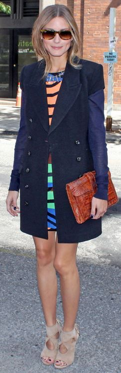 Olivia Palermo: Shirt and skirt – Tibi  Shoes – Aquazzura  Belt – BCBG  Sweater – Kooples  Purse – Hermes  Sunglasses – Ray Ban  Coat – Rachel Zoe