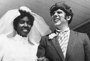 "The First Interracial Marriage in Mississippi since 1890 -- in 1970. ""Newlyweds Berta and Roger Mills, shown here on their wedding day 8/2/70, are currently living in a modest Jackson, MS apartment. They were married after a legal fight against the state law prohibiting interracial marriage""."
