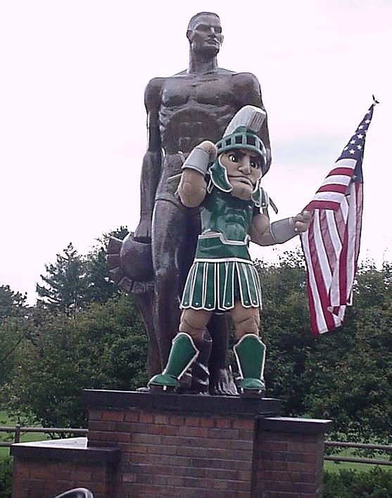 Sparty and The Spartan. Country's Best mascot. Apologies to Bevo and Scrappy! >>>  Google Image Result for http://www.msu.edu/~brownth1/images/Sparty_statue_flag.jpg
