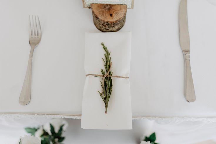 Simply perfect napkin decoration. Photo by Benjamin Stuart Photography #weddingphotography #weddingdecor #weddingbreakfast #receptiondecor #rosemary #simple