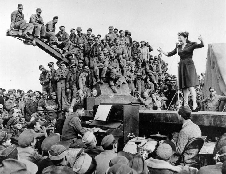 Actress-comedian Martha Raye entertains servicemen of the U.S. Army 12th Air Force on a makeshift stage on the edge of the Sahara Desert in North Africa in 1943