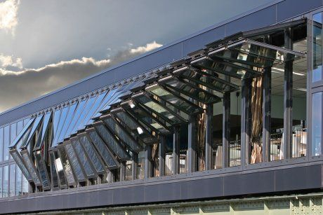 "facades comprised of adjustable components that deliver adaptability 2 buildings failed & new developments: Open restaurant in Amsterdam by CIE architects is newly constructed kinetic facade - growing collection of dynamically adaptable buildings; recently completed Q1 headquarters bldg in Essen Germany is shaded by 3,150 kinetic ""feathers"" that open & close based on user input & sensor data."
