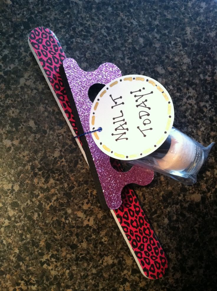 "Nail polish set w/ tag that said ""Nail It Today"" for cheer team on day of State Competition"