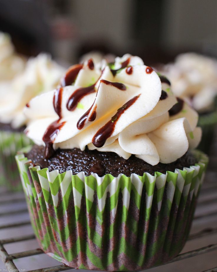 Chocolate Guinness Cupcakes with Irish Cream Frosting - Cupcakes get an incredible deep chocolate flavor from some Guinness, and they're topped off with a rich Irish Cream frosting and a chocolate sauce drizzle!