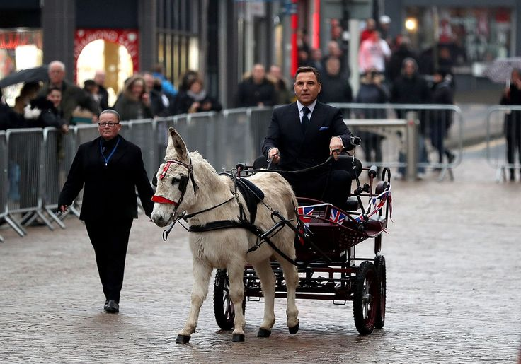 In Blackpool: Driving a donkey and cart, Britain's got talent judge, David Walliams arrives at the Opera House for an event to publicise the TV programme
