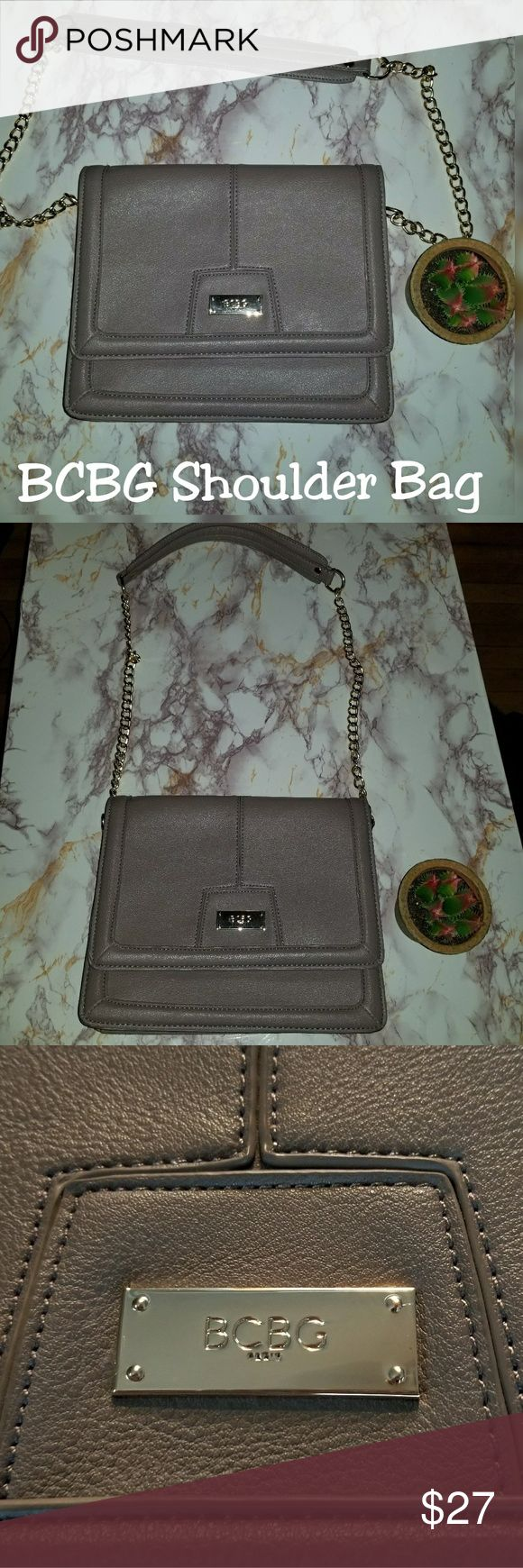Purse from BCBG Paris Brand New! Structured handbag with gold chain strap. Perfect Condition!  Beautiful stitching. BCBG Paris logo on flap. soft pvc material on shoulder strap for comfort. Taupe color. Flap top with center gold logo plate & magnetic closure.  Has a gold chainlink with leather comfort strap.   Interior is clean with 2 compartments, a zip pocket and 2 slip pockets.  New without tags.   $129 Original Price BCBG Bags Shoulder Bags
