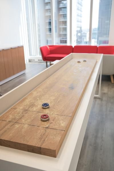 The Break Shuffleboard Table In 2020 Interior Design Living Room Shuffleboard Table Interior Design Trends
