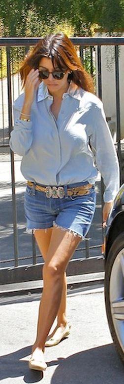 Kourtney Kardashian: Shirt – This Is A Love Song  Shorts – Fidelity  Shoes – Ralph Lauren  Shoes – Balenciaga  Sunglasses – Garrett Leight