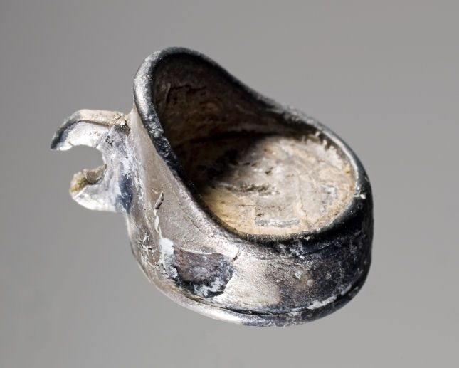 Amulet of silver in the form of a chair. It may represent the seat that the seeress sat on during seances. The amulet was found in the seeress's grave from Fyrkat, near Hobro.