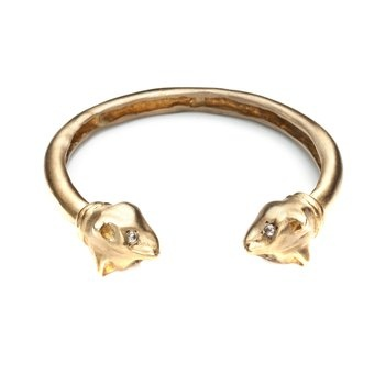 Playing Cats Cuff. Aristocratic and aloof, the cat was deified in Egyptian culture. Inspired by ancient Egypt and the Etruscans, Natalie Frigo's jewelry line is hand-sculpted in her Lower East Side, Manhattan atelier out of 100 percent recycled metals.  $270
