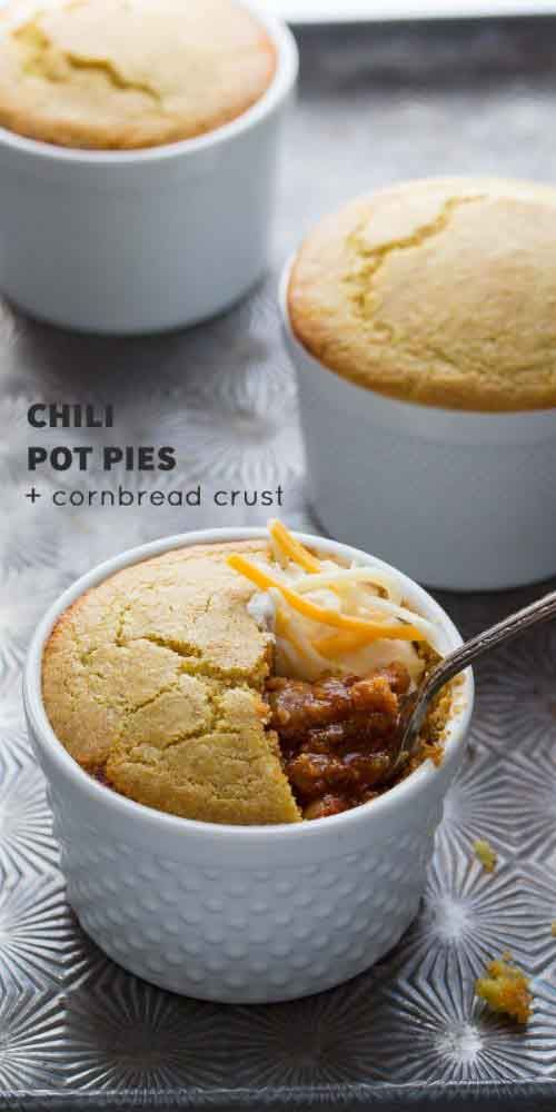 sponsored links Chili Pot Pies with Cornbread Crust Chili tastes great with cornbread. Pot Pie is one of the most comforting dishes in history, so why not combine the two? When you break in to the moist muffin to reveal the spicy juicy chili, it's a special moment! You all know how much I love a slow cooker recipe. They help my busy life, while still getting an oh so delicious meal at the end of a long day! But eating the same thing for three or four meals in a row can be boring as fast…