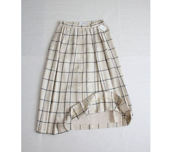1980s vintage woven silk skirt with a combination plaid and houndstooth pattern, high waist, and pleated front. This skirt has side pockets and is