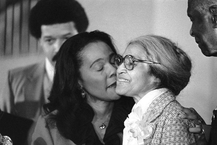 Rosa Parks, right, is kissed by Coretta Scott King. Jan. 14, 1980.