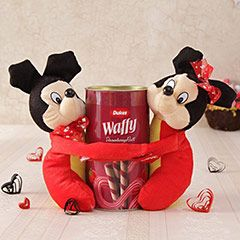 Hugging Mickey Mouse and Wafer Roll Hamper @ http://www.rakhibazaar.com/return-gifts-to-sisters-101.html