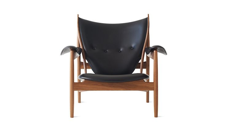 Distinctive shapes inspired by primitive weaponry and a seat that appears suspended above the frame, the sculptural form of the Chieftains Chair (1949).