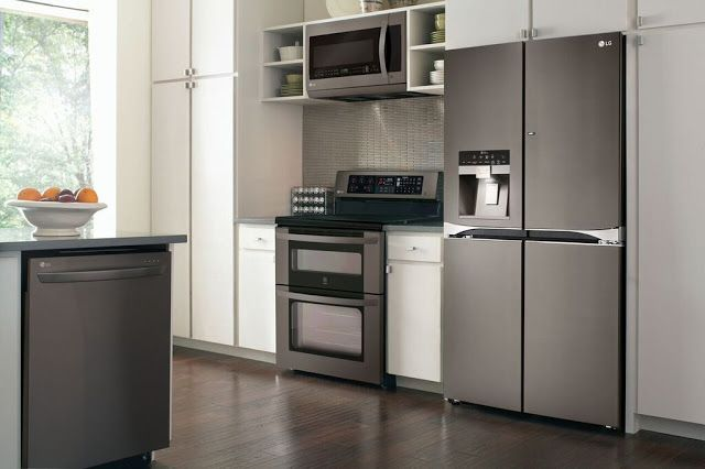 New LG appliances in use- This too modern for me. But I can see the color scheme and too much gloss and white counter tops don't seem like the way I would want to go. #LGLimitlessDesign #Contest The Chirping Moms: LG's New Black Stainless Steel & An Exciting Pinterest Contest