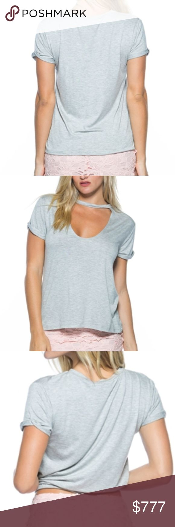 """GRAY CHOKER TEE MADE IN THE USA  This sassy choker detail tank top adds a new twist to a plain tank top. Comfortable and sassy!  Available in peach, heather gray or vintage blue  95% rayon/5%spandex Color may vary per screen Listing is for 1 top Model is wearing a Small (Waist 25"""", Bust 32D"""", Hips 36"""") . Tops Tees - Short Sleeve"""