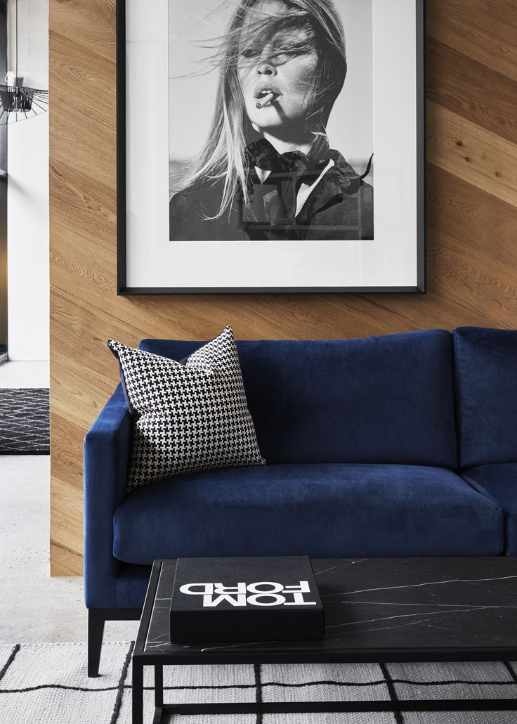 Tailored Plush Sofa, marble coffee table & iconic black & white print.