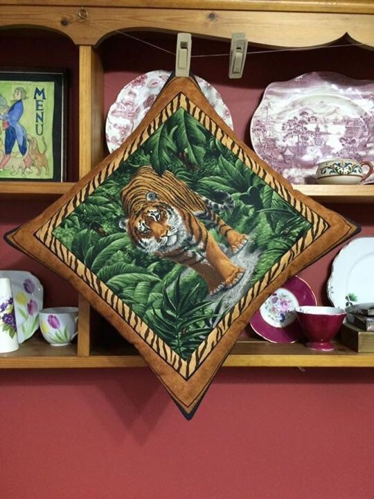 A personal favourite from my Etsy shop https://www.etsy.com/uk/listing/398513857/tiger-in-the-jungle-scene-quilted-pillow