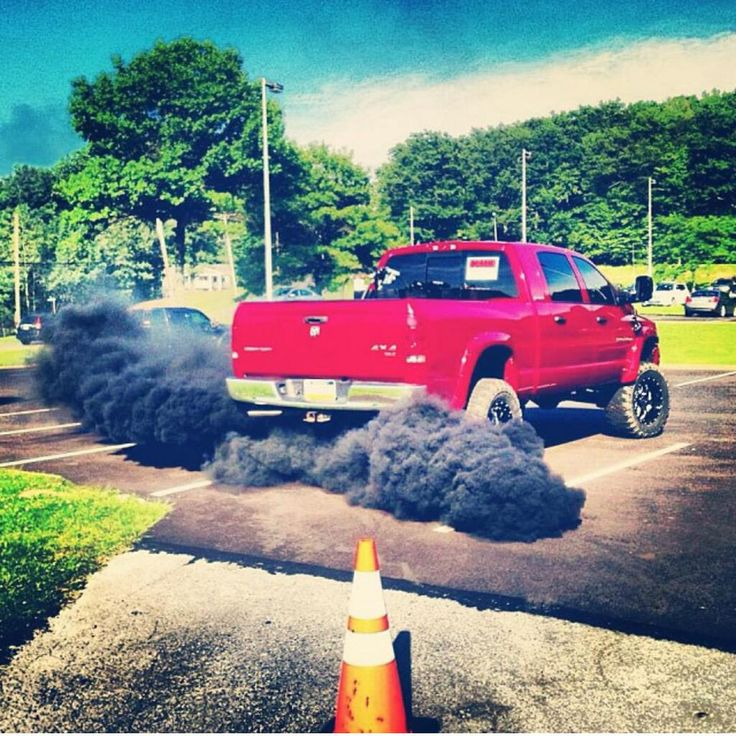 red lifted Ford diesel truck
