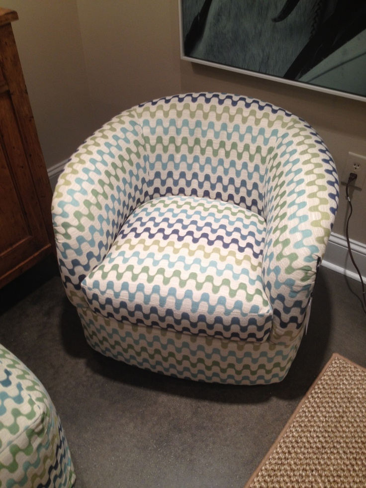 "High Point Market Spring 2012-C.R. Laine's Small Swivel Chair that ""sits"" big but will fit in a small space.  I will definitely be using this soon! The fabric is great too!"