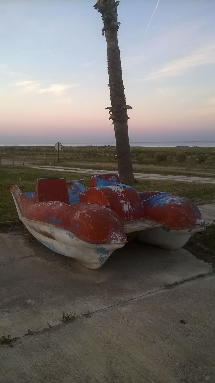 A beached pedalo. A foot propelled vehicle that can't move on land. Oh the irony, it burns.