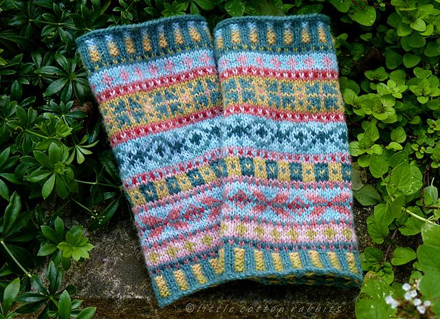 A straight tubular cuff worked in bands of Fair Isle colour-work.