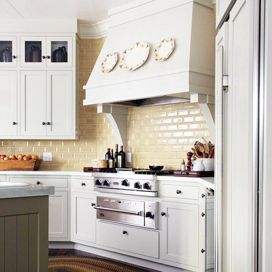 Colorful kitchen backsplash ideas stove subway tile for Butter cream colored kitchen cabinets