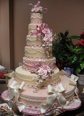 Tall lacy, gorgeous cake.