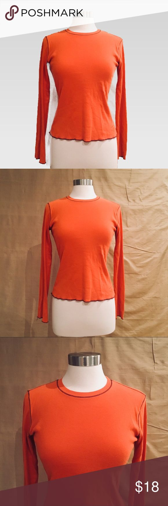 "American Eagle Outfitters Orange Long Sleeve Top S Gorgeous color on this American Eagle Outfitters orange long sleeve top. It also has brownish black stitching throughout. This is a classic staple in a great color and design. In GUC with no flaws and lots of life left. Size S.   Measurements:  Pit to pit: 17"" Sleeve: 23"" Length: 21½"" American Eagle Outfitters Tops"