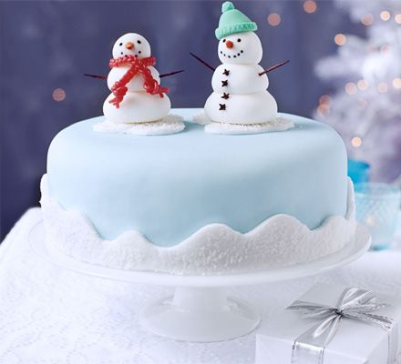 Icing and decorating a Christmas cake may take time but this sweet snowy scene will be a hit with kids
