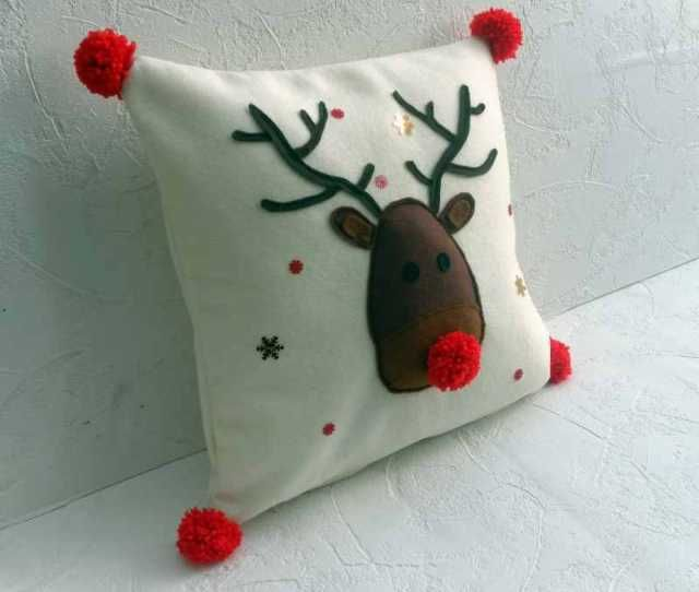 3d Rudolf Christmas cushion with handmade pom poms.  A gorgeous design that will be loved by everyone and will bring an old chair or sofa to life this Christmas.