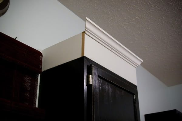 Install cabinet molding in the kitchen. I'm going to do this all the way to the ceiling...looks great, gives the illusion of height and no more dust accumulating on top.