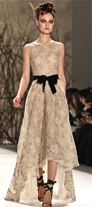 Monique Lhuillier. gold lace gown - I usually hate high low dresses, but MAN! it's simple and yet intricate, and the model's makeup is great. wow.