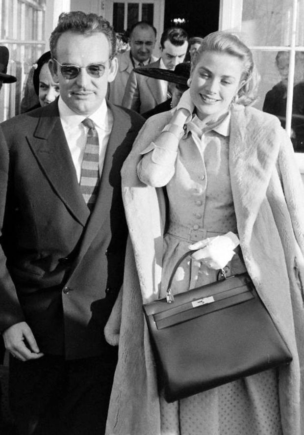Grace Kellyand Prince Rainier, shortly after announcing their engagement. [Grace is shown carrying her famousHermès Kelly Bag]