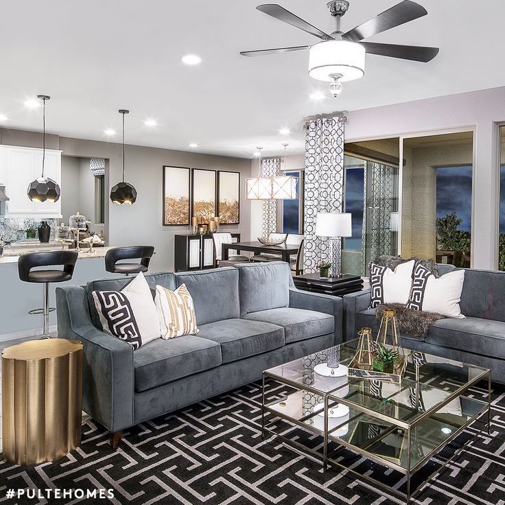 Geometric patterns and gold accents add visual interest to this modern living space! | Pulte Homes
